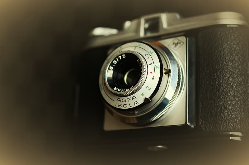 Black point-and-shoot camera in tilt shift lens photography