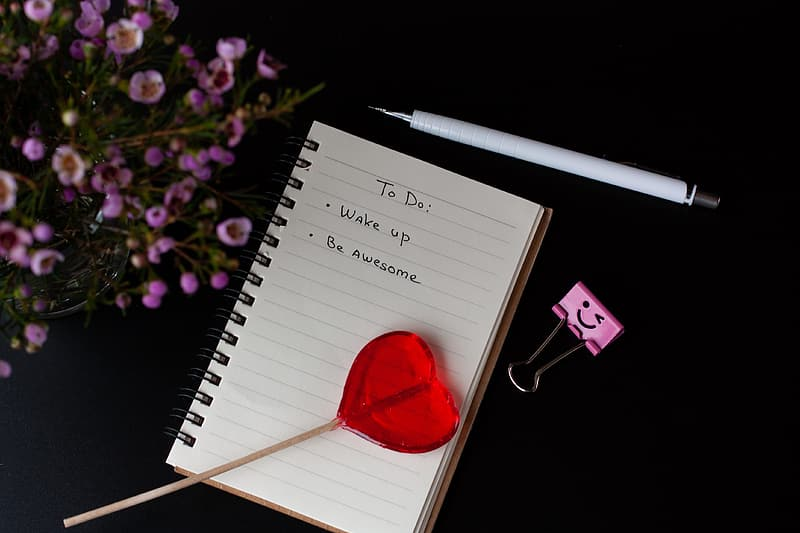 Red heart on white ruled paper