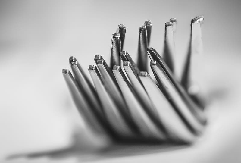Gray metal sticks in grayscale photography