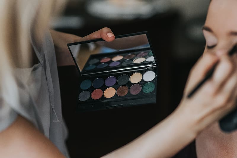 Woman holding makeup palette with makeup palette