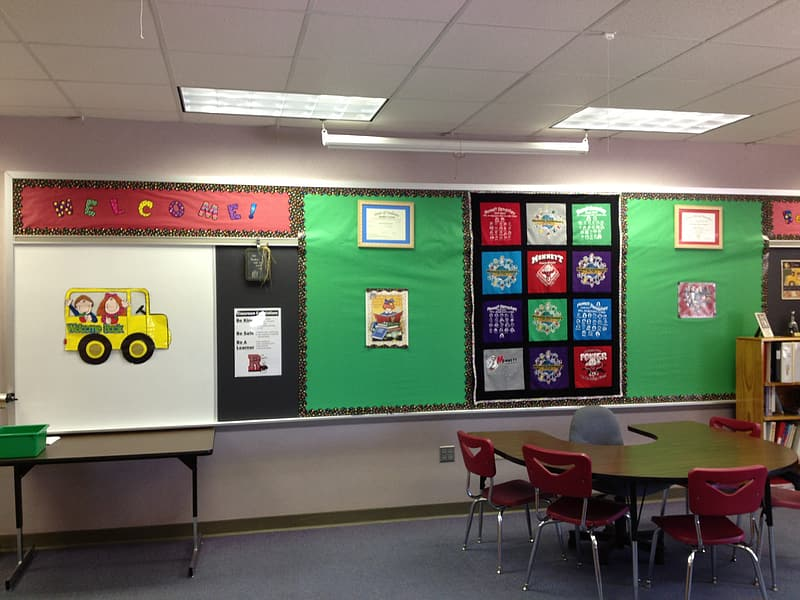 Children's assorted art works posted on chalkboard