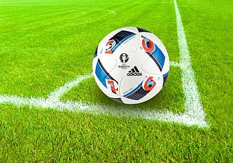 White Adidas soccer ball on field