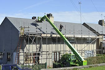 Cherry picker working on roof