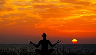 Silhouette photography of person meditating facing sun set