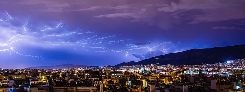High-angle photograph of city under lightning
