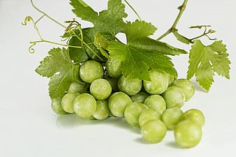 Green grapes on white table top