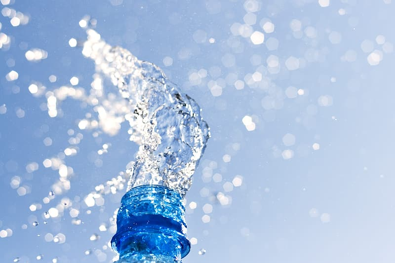 Water splash on water in close up photography