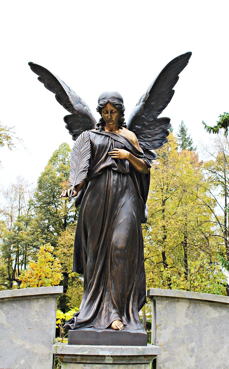 Standing female angel statue during day
