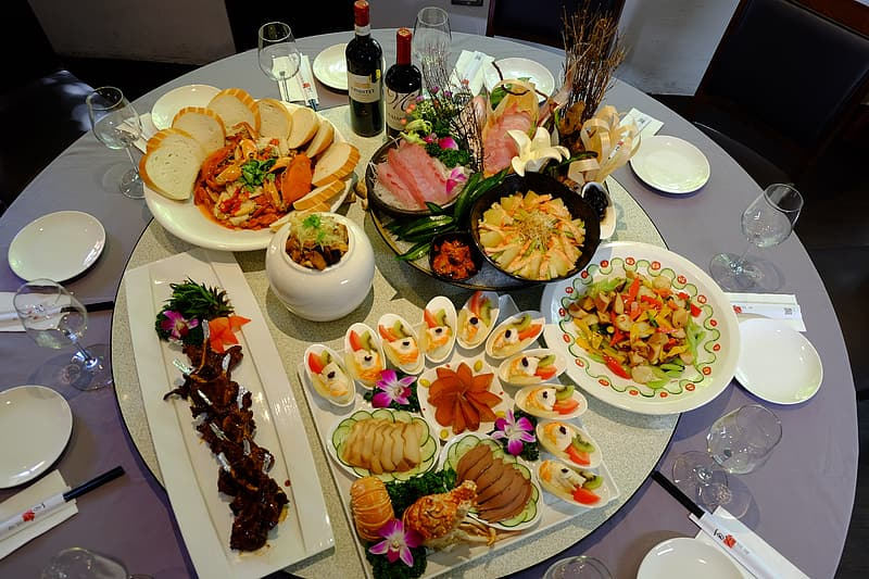 White ceramic plates with foods on table