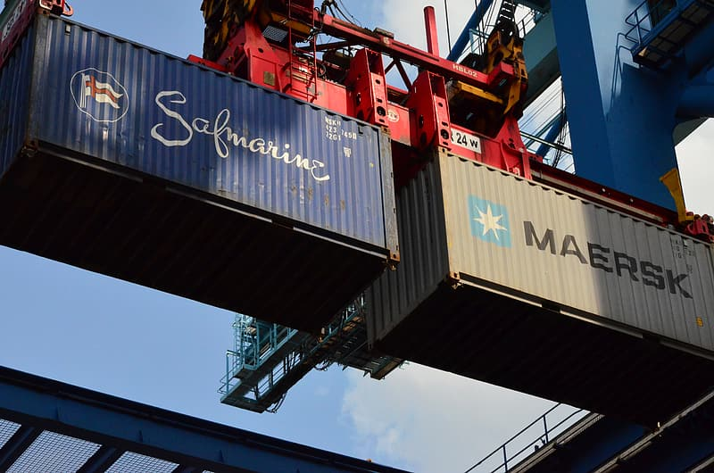 Two gray and blue intermodal containers