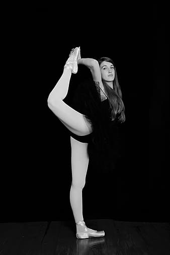 Grayscale photography of Ballerina doing trick