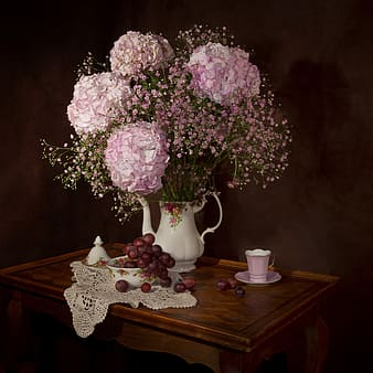 Pink and white petaled flowers with vase