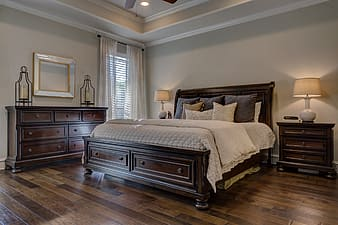 Brown wooden bed frame and brown wooden nightstand