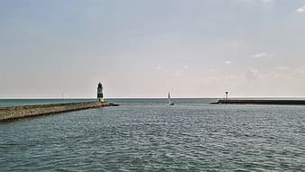 Body of water and light house