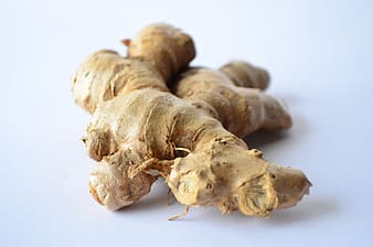 Photo of ginger on top of white surface