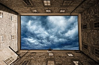 Person showing blue and white cloudy sky