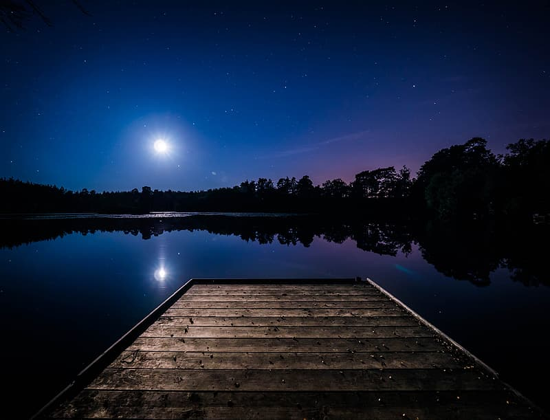 Brown wooden dock on lake during night time | Pikrepo