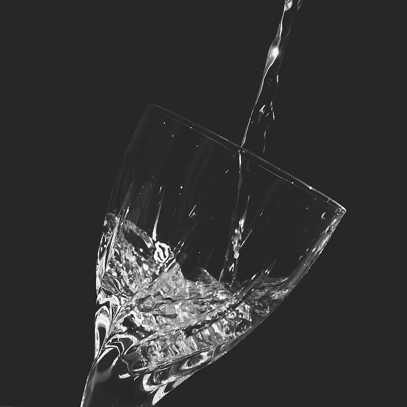 Liquid poured on clear drinking glass
