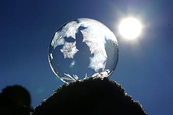 Close up photograph of round clear glass with snowflakes