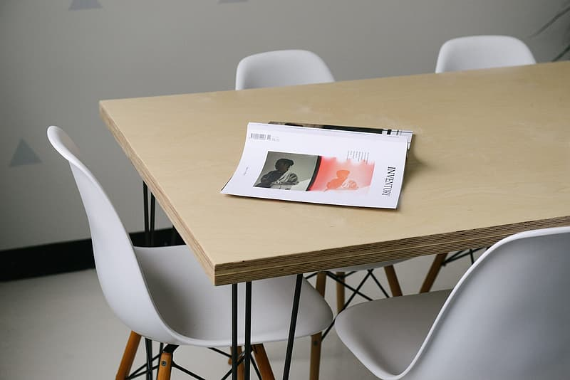 Rectangular beige dining table with chairs