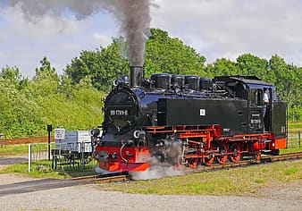 Black and red train on rail road during daytime