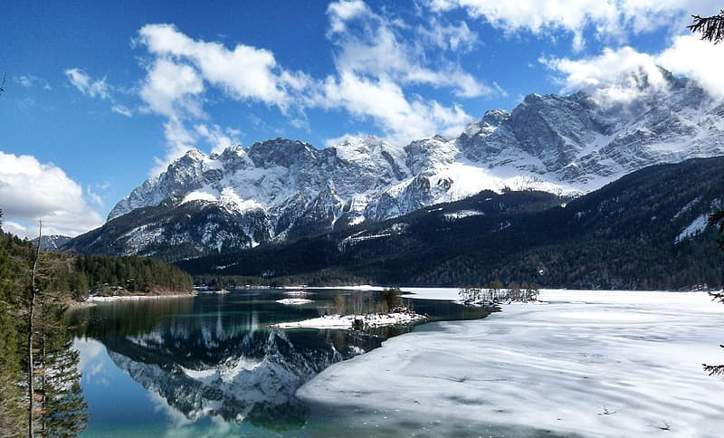Snow Covered Mountain Near Lake Under Blue Sky During