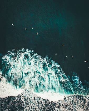 Aerial photography of boat on body of water with ocean waves