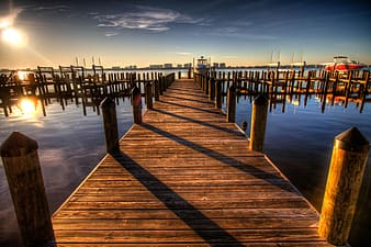 Photo of brown wooden dock during daytime