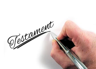 Person writing Testament text
