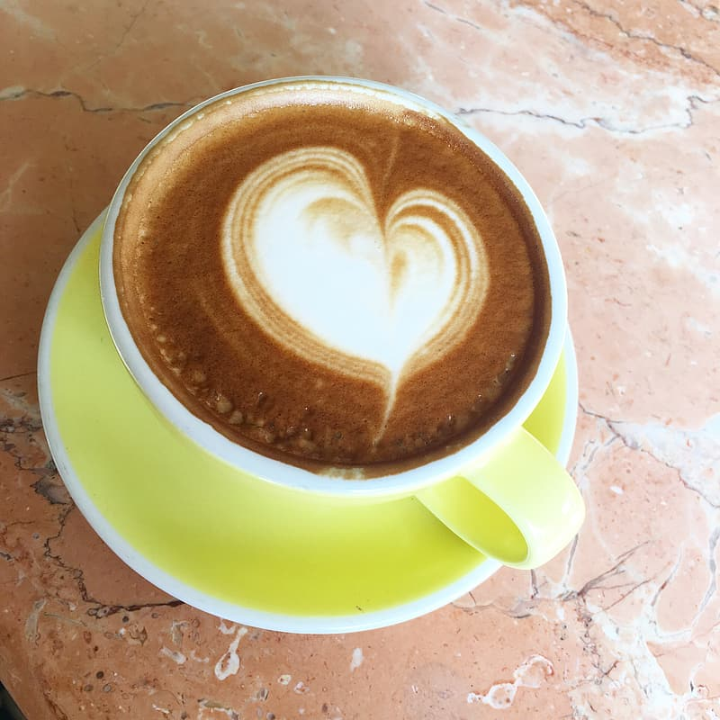 Brown and white heart shaped coffee