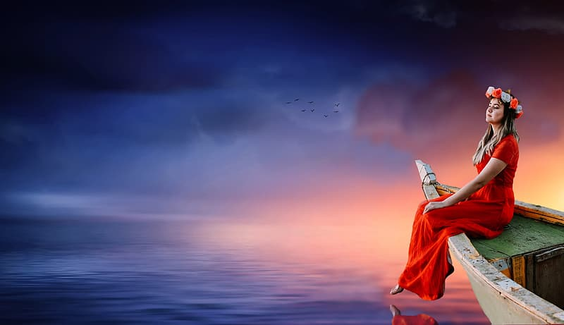 Woman wearing red dress sitting on the boat surrounded by body of water