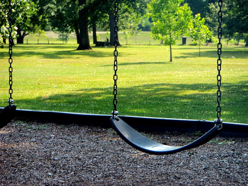 Close-up photo of blue swing during daytime