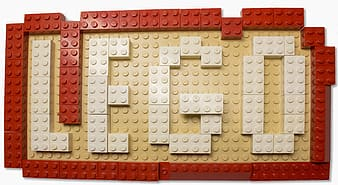 Red, yellow, and white Lego plastic building blocks
