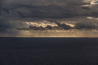 Sea and gray clouds in the horizon