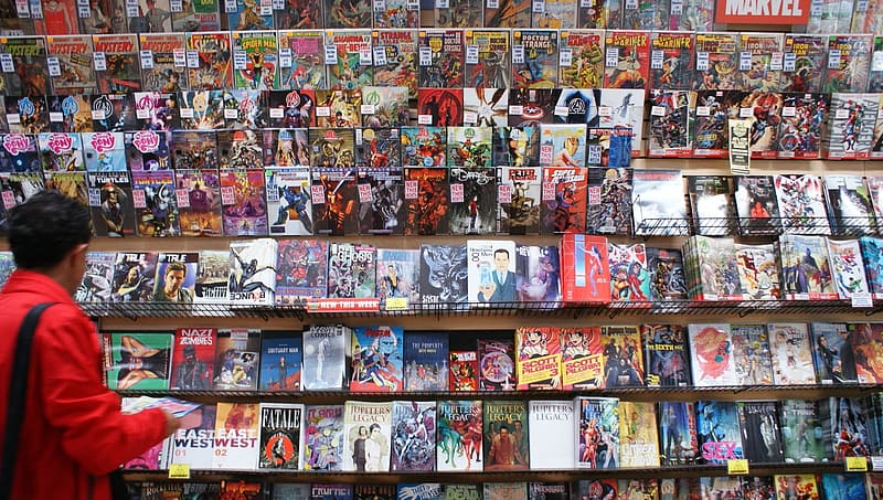 Person standing in front of comic book stand
