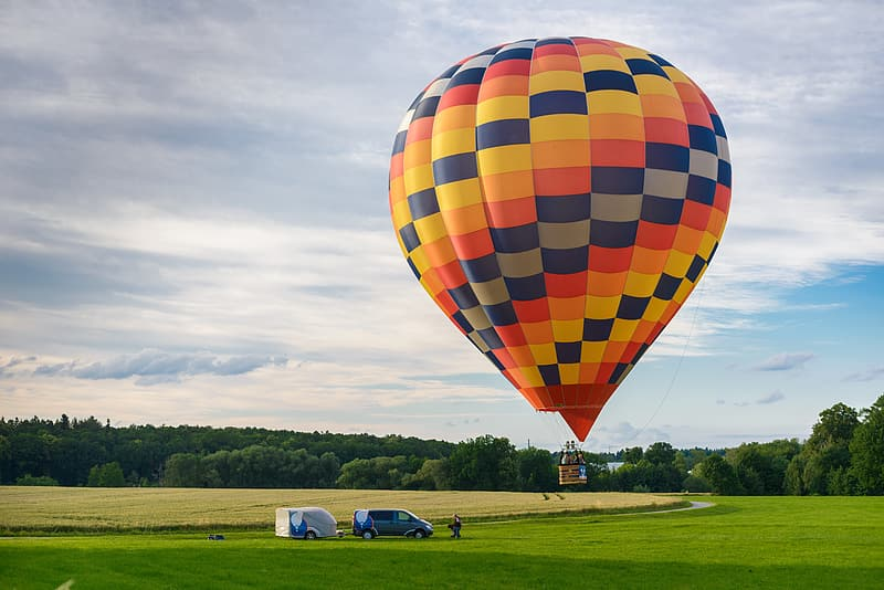 Yellow and multicolored hot air balloon on mid air at daytime