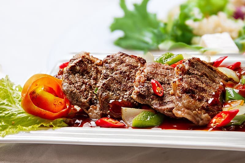 Serve of grilled meat with vegetables