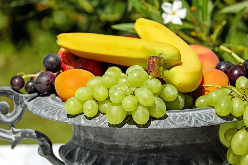 Assorted fruits in gray steel container