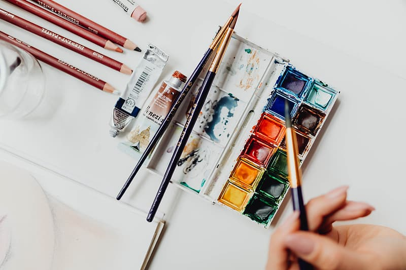 Paint brushes on white table