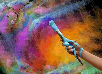 Person holding black microphone with pink yellow and blue background