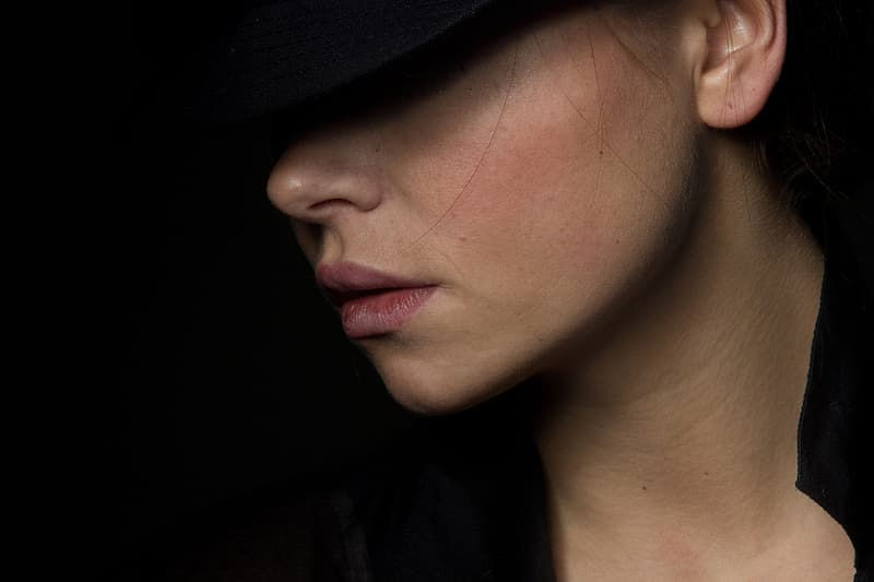 Photo of woman wearing hat and black top