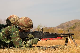 Docking soldier aiming to fire gun