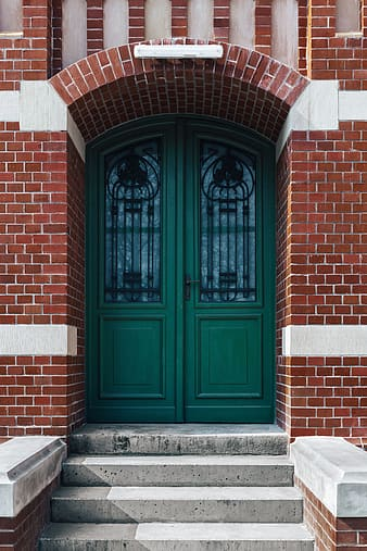 Brown wooden door with brown brick wall