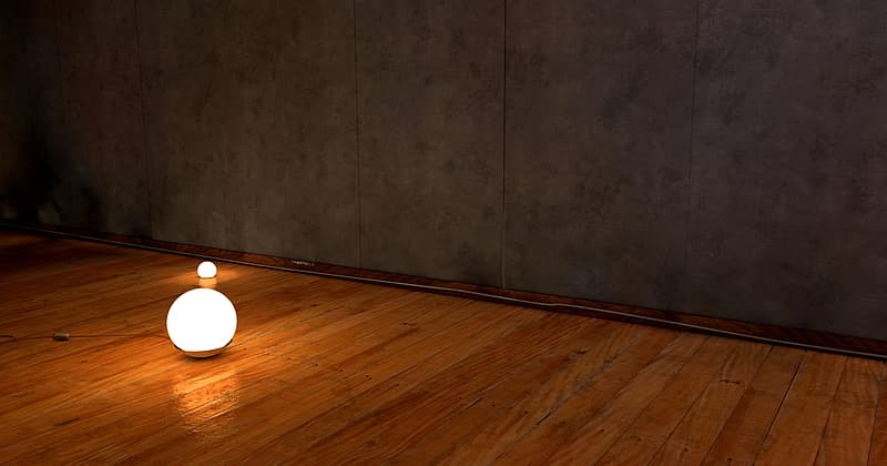 Brown wooden floor with gray wall