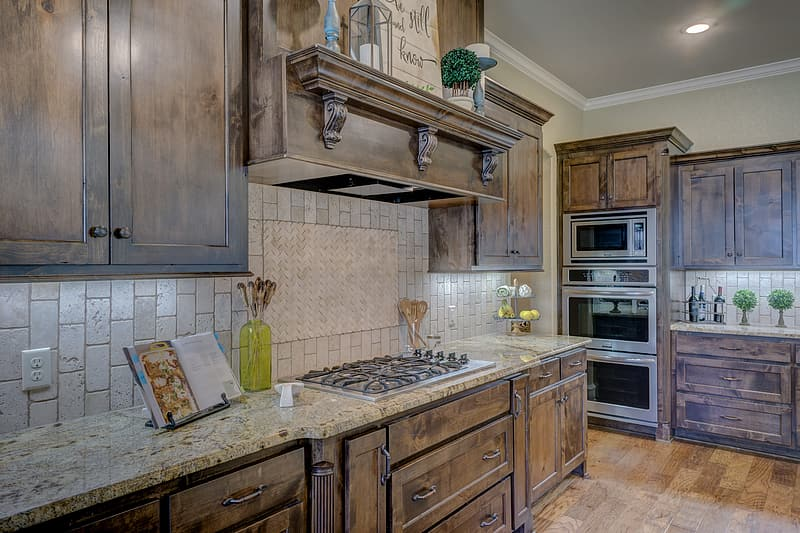 Brown wooden kitchen coutertop and ovens