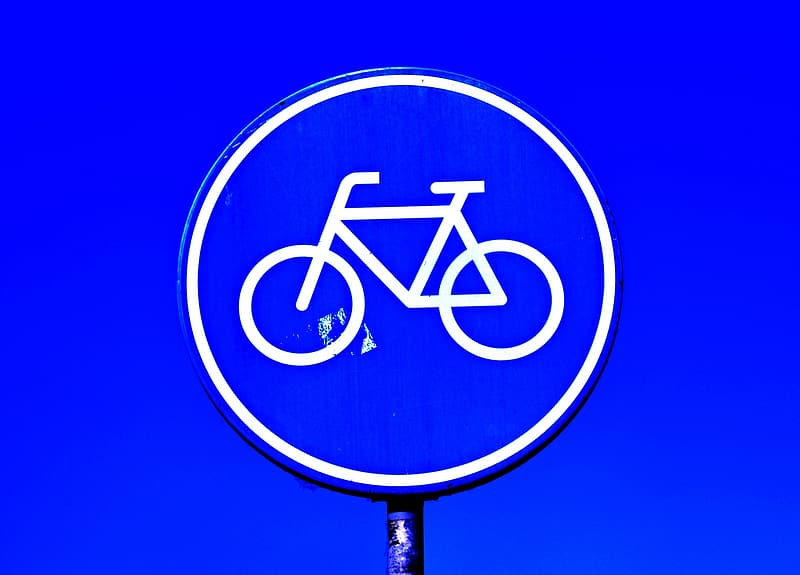 Blue and white bicycle sign