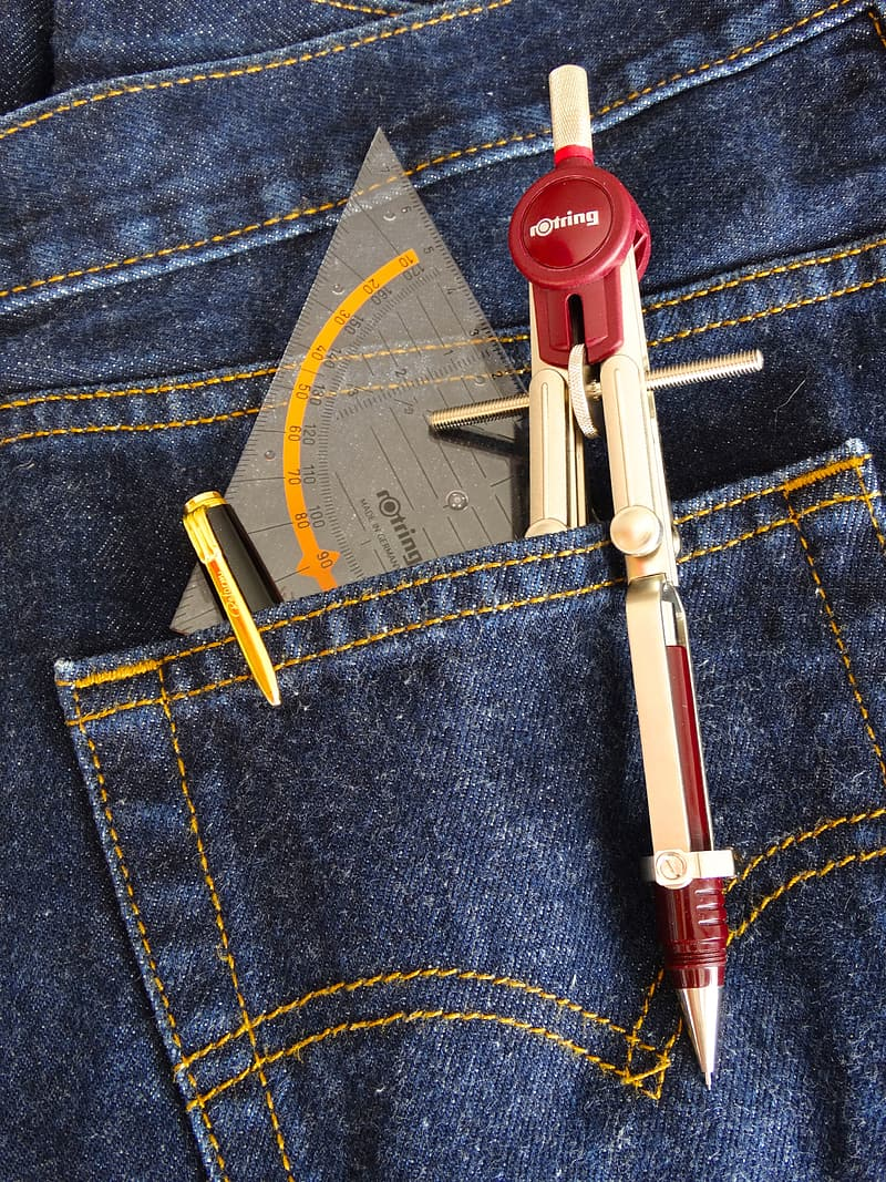 Drafting compass, pen, and protractor in jeans pocket