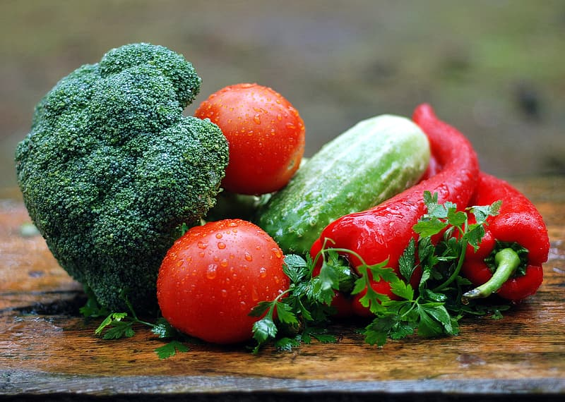 Red tomatoes, cucumber, red bell peppers, and broccoli
