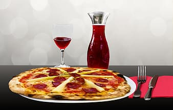 Pizza on plate with wine glass