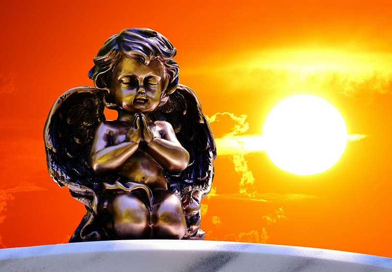 Angel statue at sunset